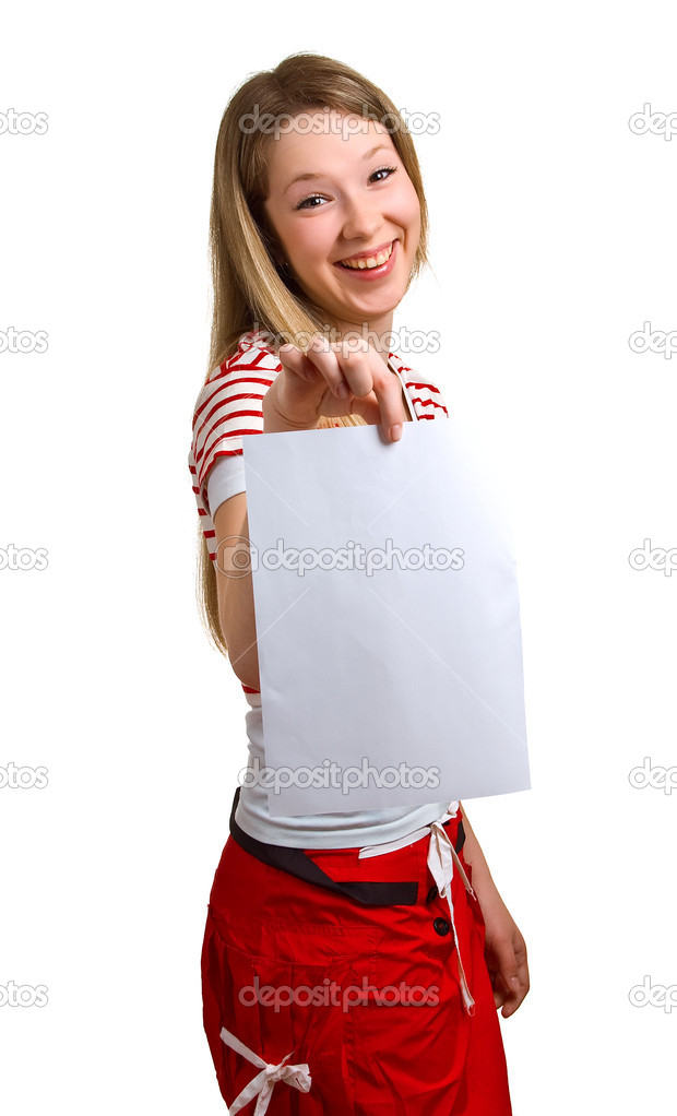 Young girl shows empty sheet of a white paper. Isolation on the white  Stock Photo #1990798