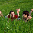 Girls lay in a green grass — Stock Photo