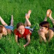 Royalty-Free Stock Photo: Girls lay in a green summer grass