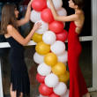 Girls decorate a premise balloons — Stock Photo