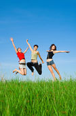 Girls jump on the meadow — Stock Photo