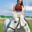 Girl astride a horse - Stok fotoraf