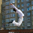 Men jumping against urban landscap — Stock Photo