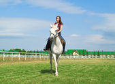 Serenity girl astride a horse — Stock Photo