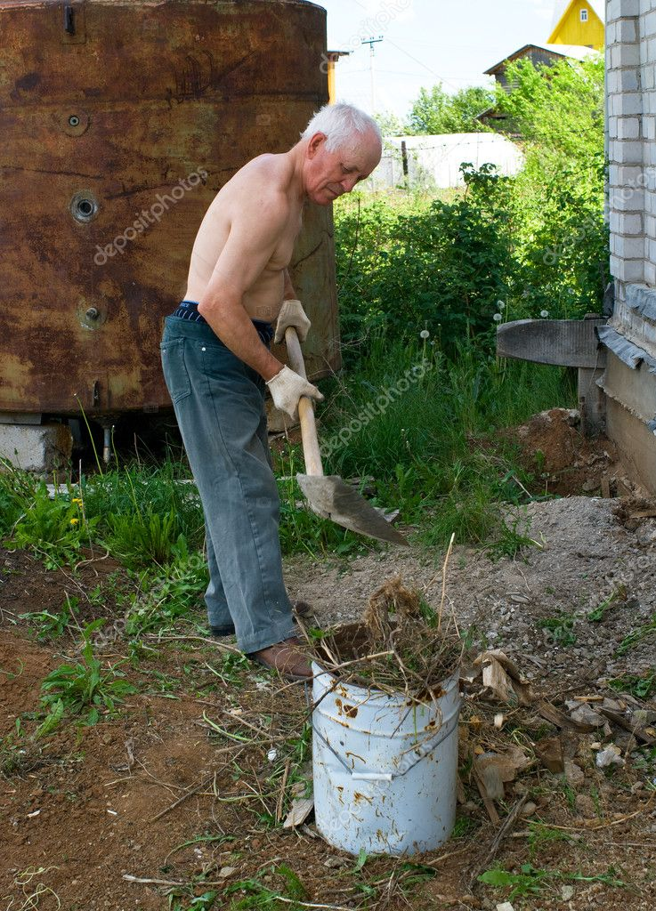 The elderly tired men is cleaned in a court yard of the house — Stock Photo #2011138