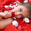 Stock Photo: Beautiful girl in rose petal