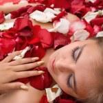 Sleeping girl in rose petal — Stock Photo #2068115