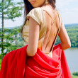 Girl in golden dress with red scarf — Stock Photo