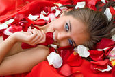 Beautiful girl in rose petal — Стоковое фото