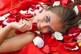 Beautiful girl in rose petal — Stock Photo