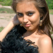 Beautiful girl in a black boa — Foto de Stock
