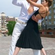 Young couple dancing Latino dance — Stock Photo