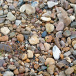 Stones on sand — Stock Photo