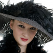 Stock Photo: Young women in black hat and boa