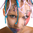 Stock Photo: Girl with plaits and geometrical makeup