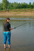 Girl fishes a fishing — Stock Photo