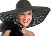 Women in black hat and boa — Stock Photo