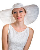 Young women in white hat and dress — Stock Photo