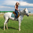 Stock Photo: Young girl astride horse