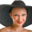 Stock Photo: Smiling women in black hat