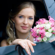 Bride in the car — Stock Photo #2128761