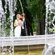 Bride and groom in summer park — Stock Photo #2128924