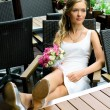 Bride on terrace of restaurant — Stock Photo