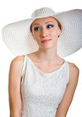 Smiling women in white hat and dress — Stock Photo