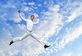 Men jumping against blue sky — Stock Photo