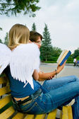 Young men and angel 3 — Stock Photo