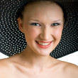 Royalty-Free Stock Photo: Smiling women in black hat