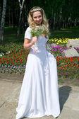 Happy bride in white — Stock Photo