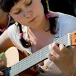 Girl plays a guitar — Stock Photo