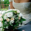 Royalty-Free Stock Photo: Bouquet against young couple