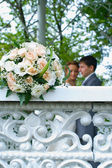 Wedding bouquet on white fence — Stock Photo