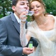 Couple blowing the soap bubbles — Stock Photo #2194395