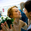 Kissing bride and groom — Stock Photo