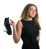 Mädchen hält schuhe in händen — Stockfoto