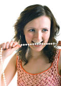 Girl holds a pearl beads — Stock Photo
