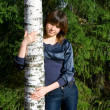 Girl against birch and furtrees - Stock Photo