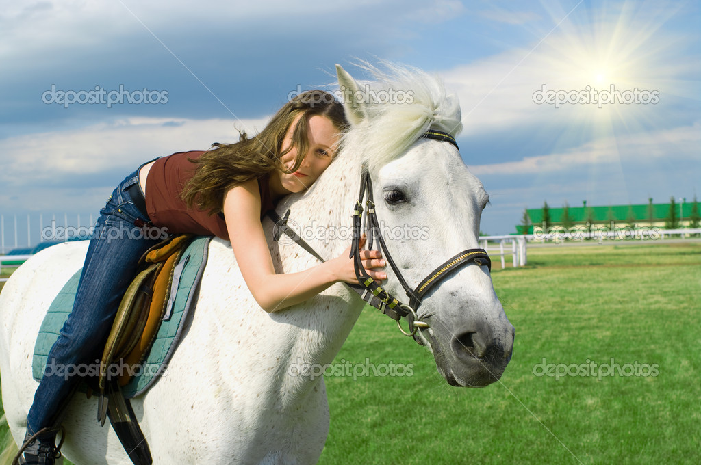 The young beautiful girl embraces a white horse  Stock Photo #2206878