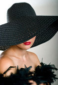 Beautiful women in black hat and boa — Stock Photo