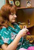 Women knits on spokes — Stock Photo