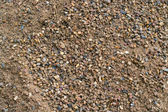 Sandy beach with small stones — Stock Photo
