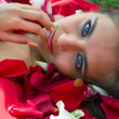 Stock Photo: Girl in rose petal