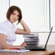 Stock Photo: Young woman in office