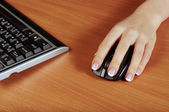 Hand with mouse — Stock Photo