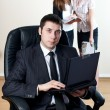 Businessman with collaborator on backside — Stock Photo