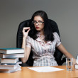 Royalty-Free Stock Photo: Secretary  sit at the table