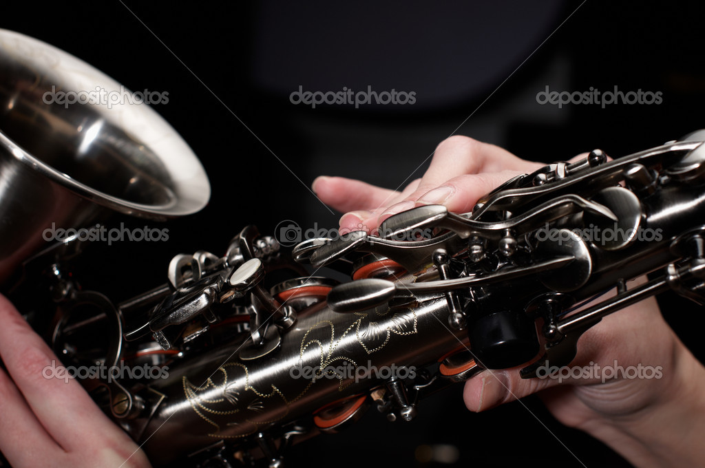 Buttons of saxophone  with fingers  Stock Photo #1352630